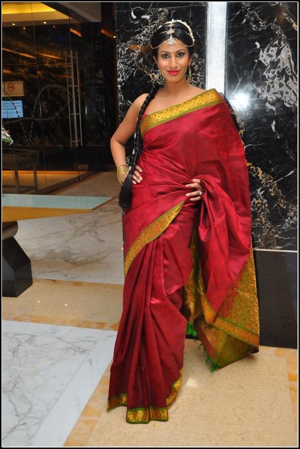 red silk saree with sleeveless blouse