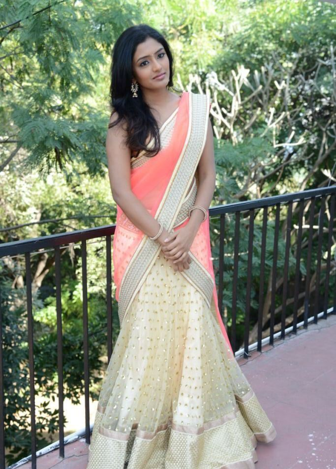 esha in embroidery half saree