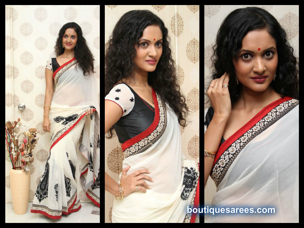 nivitha in white embroidery saree