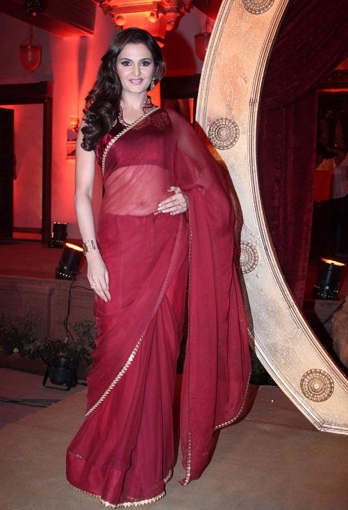 monica bedi in red plain saree