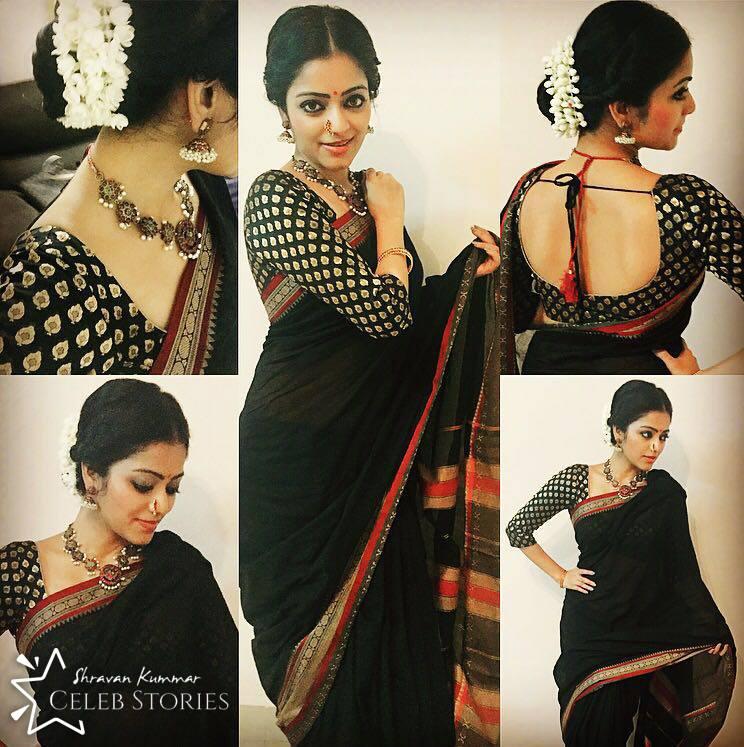 jananin in black saree